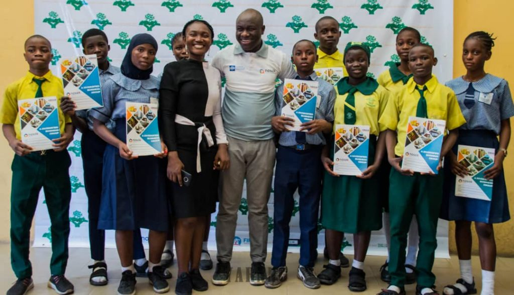 Kenneth Adejumoh, Corporate Communications Manager, Nosak Group with Irene Okon, Founder, Lead-Out Education Foundation flanked by students of Isale-Eko Senior Grammar School and King Ado Senior Secondary School during the workshop and book donation organized by Lead-Out Education Foundation in partnership with Nosak Group to mark the 2020 World Book Day in Lagos Island.